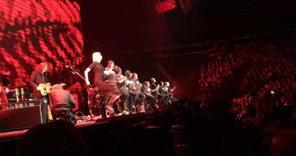 Neighborhood House Youth onstage with Roger Waters at Xcel Energy Center