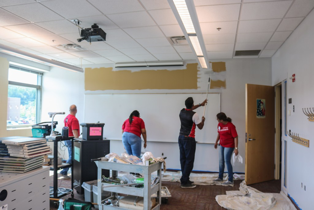 Wells Fargo volunteers painting Adult Education classrooms.